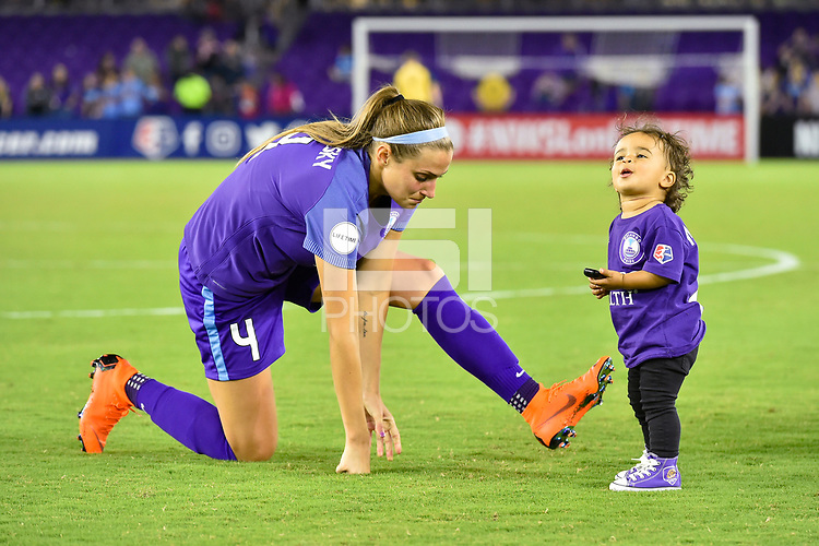 Orlando, FL - Saturday March 24, 2018: Orlando Pride defender Shelina Zadorsky (4) cools down while the child of Orlando Pride forward Sydney Leroux (2) watches after a regular season National Women's Soccer League (NWSL) match between the Orlando Pride and the Utah Royals FC at Orlando City Stadium. The game ended in a 1-1 draw.