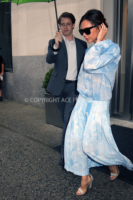 www.acepixs.com<br /> <br /> August 29 2017, New York City<br /> <br /> Victoria Beckham wears sky blue as she leaves her midtown hotel on August 29 2017 in New York City<br /> <br /> By Line: Philip Vaughan/ACE Pictures<br /> <br /> <br /> ACE Pictures Inc<br /> Tel: 6467670430<br /> Email: info@acepixs.com<br /> www.acepixs.com