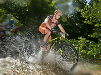 NWA Democrat-Gazette/BEN GOFF @NWABENGOFF<br /> Daryl Lobik of Bentonville fords a creek while racing in the men's category 3 race on Sunday July 17, 2016 during the cross country races at the 18th Annual Fat Tire Festival at Lake Leatherwood City Park in Eureka Springs.
