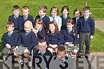 SMILES: The junior infants take time for a photo on their first day at school in Kilcummin on Monday. In front from left, Philip O'Leary and Michael Sweeney. Seated from left, Evan Murphy, Caoimhe Crowley, Beibhinn Brosnan, Charlotte Doolan and Jody Hanafin. Back from left, Nathan McCarthy, Darren Lehane, John Friel, Eimear Faly, Roisin Breen, Aibhe Murphy and Con Fleming.