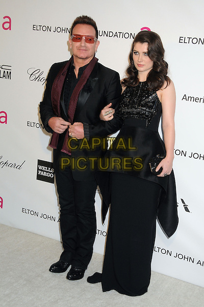 Bono of U2 (Paul David Hewson) & Eve Hewson.21st Annual Elton John Academy Awards Viewing Party held at West Hollywood Park, West Hollywood, California, USA..February 24th, 2013.oscars full length scarf suit maroon dress father dad daughter family peplum red black sunglasses shades .CAP/ADM/BP.©Byron Purvis/AdMedia/Capital Pictures.