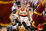 01/15/13--Portland Trail Blazers shooting guard C.J. McCollum (3) brings the ball up court against Cleveland Cavaliers in the second  half at Moda Center.<br />