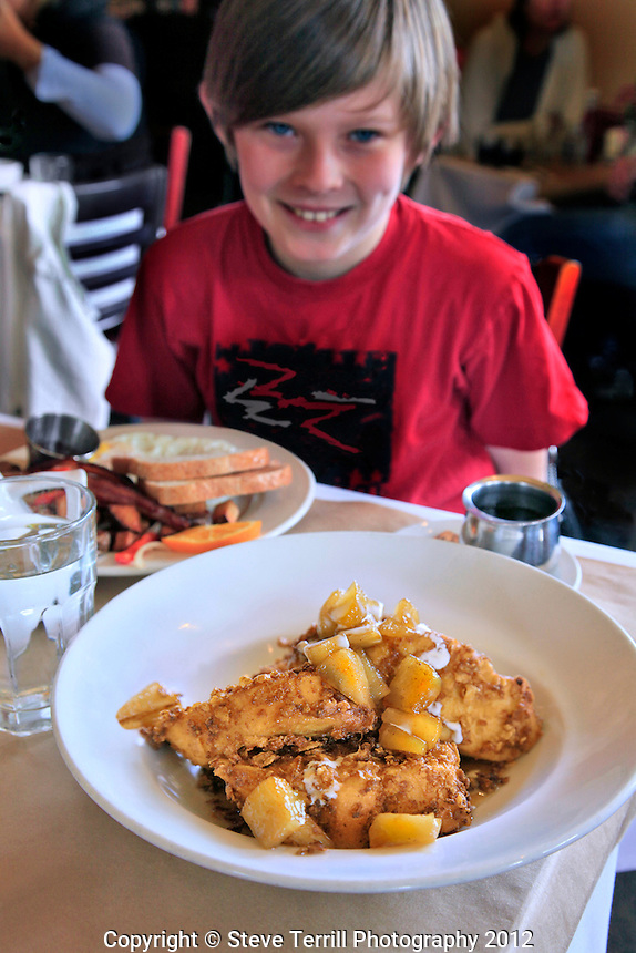 Ashton (my grandson) looking at my french toast at the Alameda Cafe in Portland, Oregon
