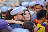 "A couple at the kiss-in pose for a selfie.To mark the 70th anniversary of the surrender of the Japanese ending WWII, the Times Square Alliance and ""Spirit of '45,"" a WWII legacy organization, hosted a kiss-in with members of the public invited to imitate the sailor and nurse in Alfred Eisenstaedt's famous photograph. (Photo by Albin Lohr-Jones / Pacific Press)"
