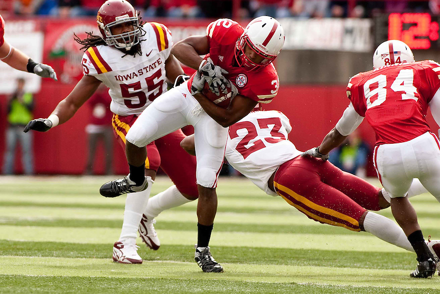 24 October 2009: Nebraska wide receiver Marcus Mendoza dodging tackles against Iowa State at Memorial Stadium, Lincoln, Nebraska. Iowa State defeated Nebraska 9 to 7.