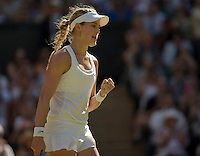 Jul 3, 2014; London, United Kingdom; Eugenie Bouchard (CAN) celebrates recording match point in her match against Simona Halep (ROU) on day 10 of the 2014 Wimbledon Championships at the All England Lawn and Tennis Club.