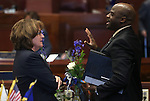 Nevada Senators Debbie Smith, D-Sparks, and Kelvin Atkinson, D-North Las Vegas, talk on the Senate floor at the Legislative Building in Carson City, Nev. on Thursday, Feb. 7, 2013. .Photo by Cathleen Allison