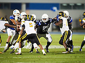 IMG Academy Ascenders guard Robert Congel (74), center Cesar Ruiz (52) and guard Curtis Dunlap jr. (77) block Jalen Carter (50) and B'Ahmad Miller (20) during a game against the St. Frances Academy Panthers on November 12, 2016 at IMG Academy in Bradenton, Florida.  IMG defeated St. Frances 38-0.  (Mike Janes Photography)