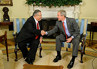 Washington, DC - June 25, 2008 -- United States President George W. Bush shakes hands with the President of Iraq Jalal Talabani after a meeting in the Oval Office of the White House in Washington, D.C. USA 25 June 2008. A roadside bombing killed three U.S. soldiers yesterday in northern Iraq, bringing the number of American troop deaths this week in the country to seven.<br /> CAP/MPI/CNP/RS<br /> &copy;RS/CNP/MPI/Capital Pictures