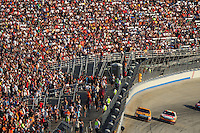 Sept. 21, 2008; Dover, DE, USA; Nascar Sprint Cup Series drivers Matt Kenseth (left) and Greg Biffle race for the lead during the Camping World RV 400 at Dover International Speedway. Mandatory Credit: Mark J. Rebilas-