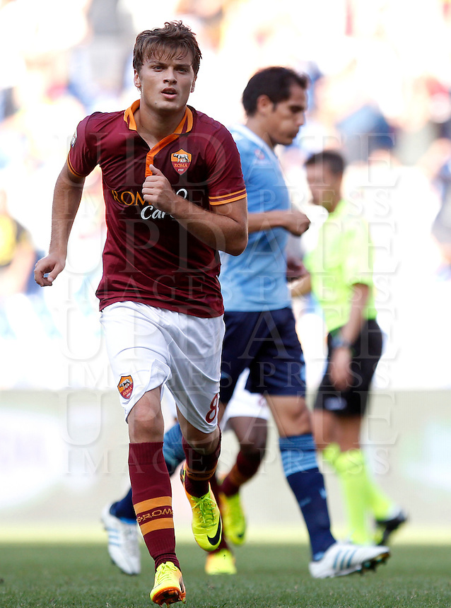 Calcio, Serie A: Roma vs Lazio. Roma, stadio Olimpico, 22 settembre 2013.<br /> AS Roma forward Adem Ljajic, of Serbia,  celebrates after scoring on a penalty kick during the Italian Serie A football match between AS Roma and Lazio, at Rome's Olympic stadium, 22 September 2013.<br /> UPDATE IMAGES PRESS/Isabella Bonotto