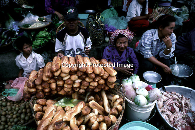 Women selling fruit and food at a market on March 12, 1998 in central Phnom Penh, Cambodia. A country trying to recover from the Kmer Rouge occupation, and the atrocities that has affected most families in the country. .(Photo: Per-Anders Pettersson/ Liaison Agency)