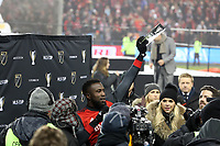 Toronto, Ontario - Saturday December 09, 2017: Jozy Altidore holds his MLS Cup MVP Trophy overhead. Toronto FC defeated the Seattle Sounders FC 2-0 in MLS Cup 2017, Major League Soccer's (MLS) championship game played at BMO Field.