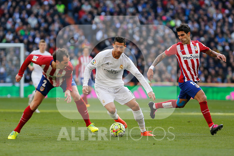 Real Madrid´s Cristiano Ronaldo and Atletico de Madrid´s Diego Godin and Mayoral during 2015/16 La Liga match between Real Madrid and Atletico de Madrid at Santiago Bernabeu stadium in Madrid, Spain. February 27, 2016. (ALTERPHOTOS/Victor Blanco)