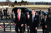 United States President-elect George W. Bush is escorted into the Pentagon in Washington, DC by US Secretary of Defense William S. Cohen on January 10, 2001.  Bush, US Vice President-elect Dick Cheney and members of their National Security team will meet with Cohen and Chairman of the Joint Chiefs of Staff Gen. Henry H. Shelton, U.S. Army, and be briefed by the Joint Chiefs in the Tank.  The Tank is the secure conference room of the Joint Chiefs of Staff.               <br /> Mandatory Credit: Helene C. Stikkel / DoD via CNP