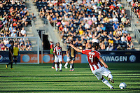 Michael Umana (4) of CD Chivas USA takes a free kick. The Philadelphia Union defeated CD Chivas USA 3-0 during a Major League Soccer (MLS) match at PPL Park in Chester, PA, on September 25, 2010.
