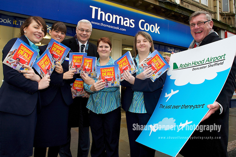Pix: Shaun Flannery/shaunflanneryphotography.com...COPYRIGHT PICTURE>>SHAUN FLANNERY>01302-570814>>07778315553>>..11th January 2011................Robin Hood Airport Doncaster Sheffield..Thomas Cook Travel agents..Craig Richmond (left), CEO Peel Airports Limited and Mike Morton (right), Robin Hood Airport Director join staff at Thomas Cook, St Sepulchre Gate, Doncaster..Zoe Seymour, Amy Sampson, Sarah Delaney, Lisa Hall.L-R Zoe Seymour, Lisa Hall and Julie Saul.