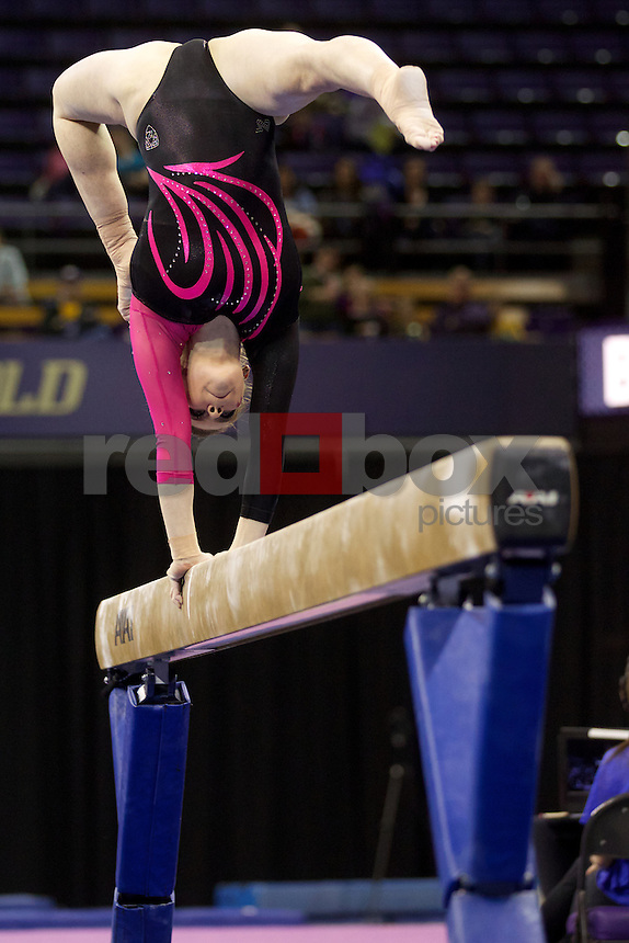 The University of Washington gymnastics team hosts Utah at Alaska Airlines Arena on Friday February 15, 2013. (Photo by Stephen Brashear /Red Box Pictures)