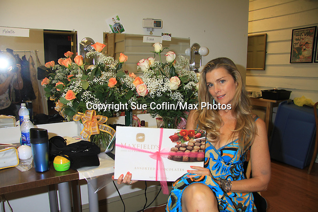 """Fiona Hutchison receives flowers and candy from Guiding Light's Justin Deas who was to star with her in this play (flowers for all the cast members) on Night after Opening Night - God of Carnage - June 22, 2012 and continues through August 3. Fiona Hutchison (Guiding Light, One Life To Live)  in """"God of Carnage"""" at The Cape May Stage in Cape May, New Jersey. (Photo by Sue Coflin/Max Photos)"""