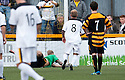 Dumbarton's Scott Agnew scores their second goal from the spot.