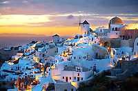 Oia ( Ia ) Santorini - Windmills and town at sunset, Greek Cyclades islands - Photos, pictures and images