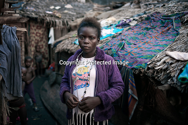 MBANDAKA, DEMOCRATIC REPUBLIC OF CONGO APRIL 12: Nicolette Bopunza, age 14, a young prostitute stand outside her house on April 12, 2006 in the port in Mbandaka, Congo, DRC. She lives and works in the port, and she stays with three other girls in the same age in a small room. Nicolette and her friends charge about 50 cents for sex and about US$ 2 for a whole night. Their clients are mainly dockworkers and crewmembers on visiting boats. The Congo River is a lifeline for millions of people, who depend on it for transport and trade. Congo is planning to hold general elections by July 2006, the first democratic elections in forty years. (Photo by Per-Anders Pettersson)