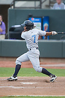 Carlos Garcia (7) of the Wilmington Blue Rocks follows through on his swing against the Winston-Salem Dash at BB&T Ballpark on June 10, 2015 in Winston-Salem, North Carolina.  The Blue Rocks defeated the Dash 11-5.  (Brian Westerholt/Four Seam Images)