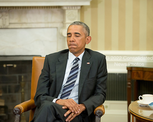 United States President Barack Obama pauses as he makes remarks to the media after receiving an update on the investigation into the attack in Orlando, Florida in the Oval Office of the White House in Washington, DC on Monday, June 13, 2016. <br /> Credit: Ron Sachs / Pool via CNP