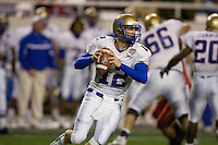 23 December 2006: Tulsa quarterback Paul Smith (#12) looks to pass the ball during the 2006 Bell Helicopters Armed Forces Bowl between The University of Tulsa and The University of Utah at Amon G. Carter Stadium in Fort Worth, TX.