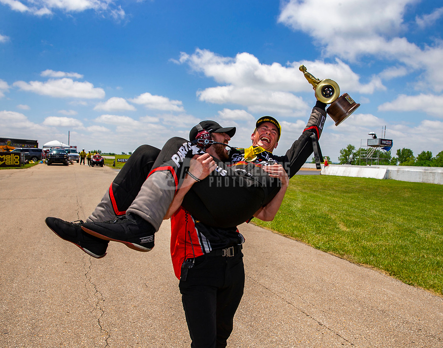 May 21, 2018; Topeka, KS, USA; NHRA top fuel driver Clay Millican celebrates with a crew member after winning the Heartland Nationals at Heartland Motorsports Park. Mandatory Credit: Mark J. Rebilas-USA TODAY Sports