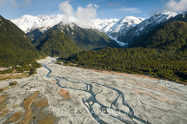 Aerial views of The Southern Alps and Franz Josef Glacier. Waiho River and Waiho Loop, ancient glacier moraine in foreground, Westland National Park, World Heritage Area, West Coast, New Zealand