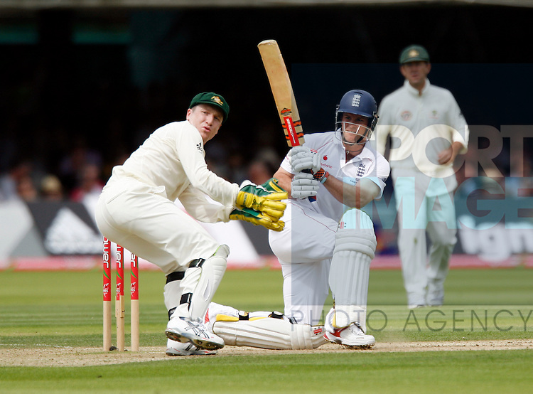 England's Andrew Strauss sweeps the ball past Brad Haddin