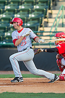 John Wooten (22) of the Hagerstown Suns follows through on his swing against the Hickory Crawdads at L.P. Frans Stadium on May 7, 2014 in Hickory, North Carolina.  The Suns defeated the Crawdads 4-2.  (Brian Westerholt/Four Seam Images)