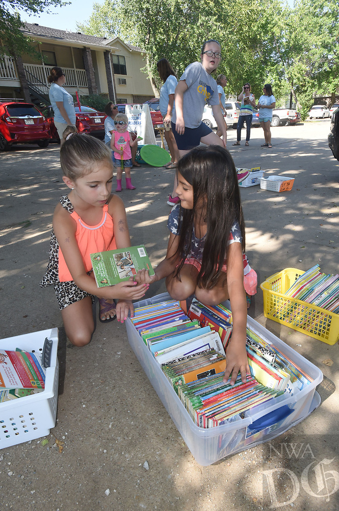 NWA Democrat-Gazette/FLIP PUTTHOFF<br />Audrey Price (left) and Leah Phinney look at books Tuesday July 11, 2017 provided by Tiller Elementary in Rogers for summer reading.