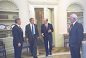 United States President George W. Bush talks to Federal Reserve Board Chairman Alan Greenspan, Treasury Secretary Paul O'Neill and White House Chief of Staff Andy Card in the Oval Office of the White House in Washington, DC, after their lunch meeting Thursday, August 1, 2002.<br /> Mandatory Credit: Eric Draper / White House via CNP
