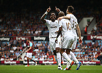 Andre Ayew of Swansea celebrates scoring his sides second goal with team-mate  Leroy Fer  of Swansea   during the Barclays Premier League match between West Ham United and Swansea City  played at Boleyn Ground , London on 7th May 2016