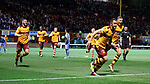 Peter Hartley heads in the second goal for Motherwell and celebrates