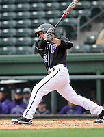 First baseman Jarrod Rickman (42) of the Furman University Paladins hits in a game against the Northwestern Wildcats on Saturday, February 16, 2013, at Fluor Field in Greenville, South Carolina. The game was cancelled in the fifth inning due to snow. (Tom Priddy/Four Seam Images)