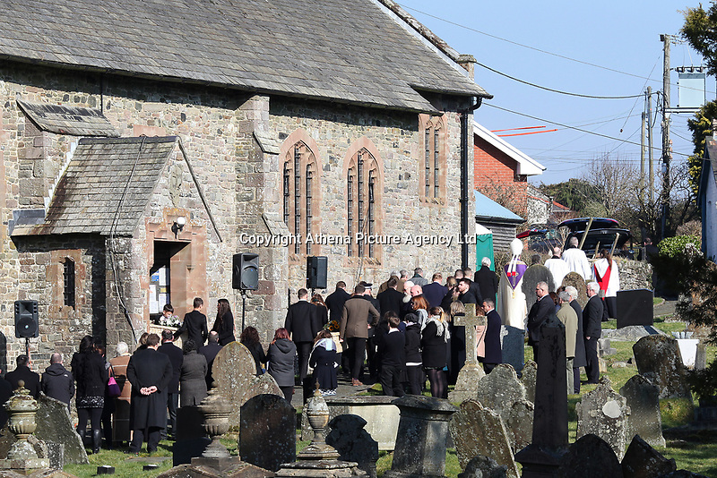 """Pictured: People attend the funeral at St Cadmarch's Church. Saturday 24 February 2018<br /> Re: The funeral of David Cuthbertson and his five children who died in a house fire in Llangammarch Wells, Powys, will take place at St Cadmarch's Church, on Saturday 24 February 2018.<br /> 68 year old David Cuthbertson, 68, died in the fire in October along with children Gypsy Grey Raine, 4, Patch Raine, 6, Misty Raine, 9, Reef Raine, 10, and Just Raine, 11.<br /> Three other children escaped the fire. The cause is being treated as unexplained.<br /> Dyfed Powys Police previously said an operation to dismantle about tonnes of bricks and mortar from the gutted house was being done """"brick by brick"""" so that evidence is preserved."""