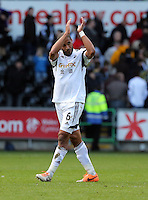 Saturday, 15 March 2014<br /> Pictured: A rather dejected Ashley Williams of Swansea is thanking home supporters after the final whistle.<br /> Re: Barclay's Premier League, Swansea City FC v West Bromwich Albion at the Liberty Stadium, south Wales, UK.