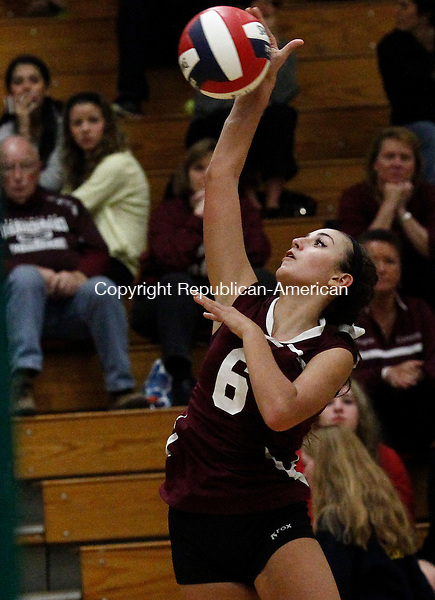 Waterbury, CT- 28 October 2014-102814CM03- Torrington's Carissa Carbone jumps up for the kill during their NVL matchup against Woodland in Waterbury on Tuesday.  With the win, Woodland advanced to the NVL finals.     Christopher Massa Republican-American