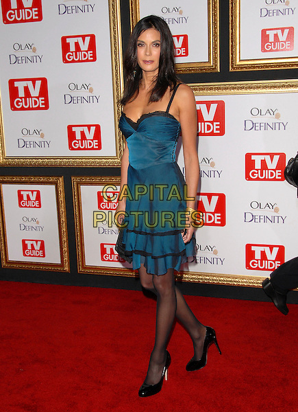 TERI HATCHER.attends The TV Guide Post Emmy Party 2007 held at Les Deux in Hollywood, California, USA, September 16 2007.                                                                                        full length blue teal dress black lace trim clutch bag tights patent shoes.CAP/DVS.©Debbie VanStory/Capital Pictures