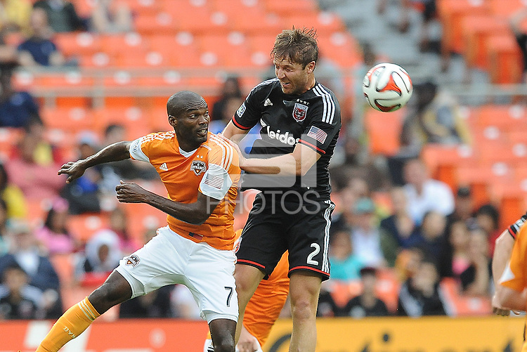 Washington D.C. - May 17, 2014: Jeff Parke (2) of D.C. United heads the ball against Omar Cummings (7) of Houston Dynamo.  D.C. United defeated  the Houston Dynamo 2-0 during a Major League Soccer match for the 2014 season at RFK Stadium.