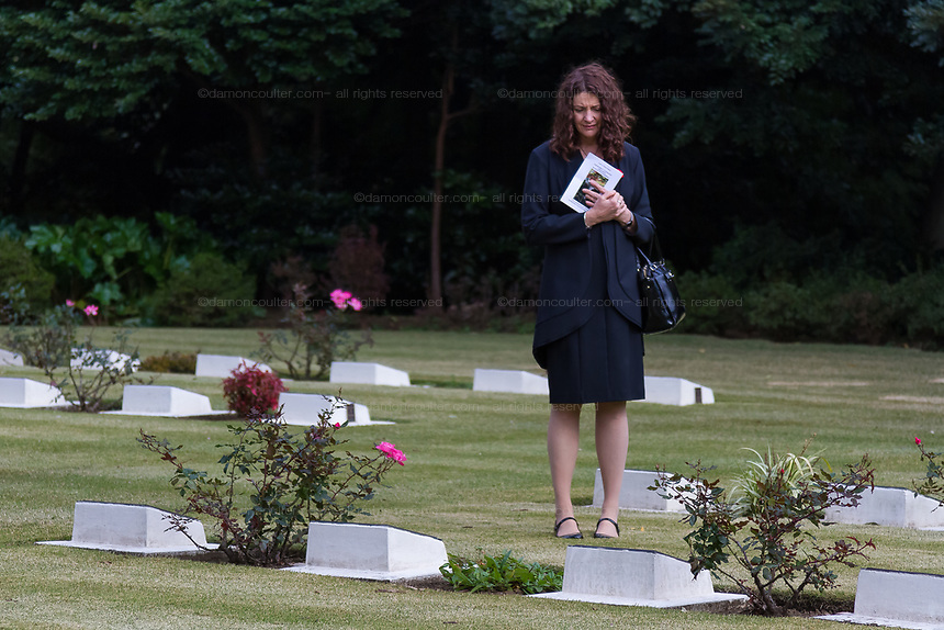 A woman looks at war graves after the Remembrance Sunday ceremony at the Hodogaya, Commonwealth War Graves Cemetery in Hodogaya, Yokohama, Kanagawa, Japan. Sunday November 12th 2017. The Hodagaya Cemetery holds the remains of more than 1500 servicemen and women, from the Commonwealth but also from Holland and the United States, who died as prisoners of war or during the Allied occupation of Japan. Each year officials from the British and Commonwealth embassies, the British Legion and the British Chamber of Commerce honour the dead at a ceremony in this beautiful cemetery.