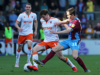 Blackpool's Matty Virtue-Thick battles with Scunthorpe United's Josh Morris<br /> <br /> Photographer David Shipman/CameraSport<br /> <br /> The EFL Sky Bet League One - Scunthorpe United v Blackpool - Friday 19th April 2019 - Glanford Park - Scunthorpe<br /> <br /> World Copyright © 2019 CameraSport. All rights reserved. 43 Linden Ave. Countesthorpe. Leicester. England. LE8 5PG - Tel: +44 (0) 116 277 4147 - admin@camerasport.com - www.camerasport.com
