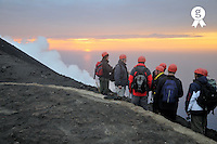 Hikers on ridge of Stromboli volcano watching fumaroles at sunset (Licence this image exclusively with Getty: http://www.gettyimages.com/detail/sb10069713i-001 )