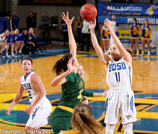 BROOKINGS, SD - JANUARY 6: Madison Guebert #11 from South Dakota State University spots up for a jumper against North Dakota State University  during their game Saturday afternoon at Frost Arena in Brookings, SD. (Photo by Dave Eggen/Inertia)
