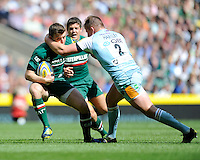 George Ford of Leicester Tigers is tackled by Dylan Hartley of Northampton Saints during the Aviva Premiership Final between Leicester Tigers and Northampton Saints at Twickenham Stadium on Saturday 25th May 2013 (Photo by Rob Munro)