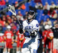 Josh Offit (25) of Duke passes the ball during the Face-Off Classic in at M&T Stadium in Baltimore, MD