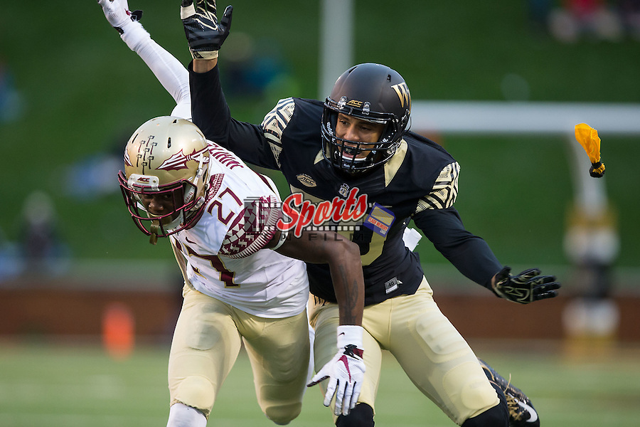 K.J. Brent (80) of the Wake Forest Demon Deacons draws a pass interference penalty on Marquez White (27) of the Florida State Seminoles during second half action at BB&T Field on October 3, 2015 in Winston-Salem, North Carolina.  The Seminoles defeated the Demon Deacons 24-16.   (Brian Westerholt/Sports On Film)